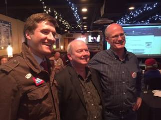 Jesse with Centre County Commissioners Mike Pipe and Mark Higgins, standing next to each other in a restaurant on election night 2015.